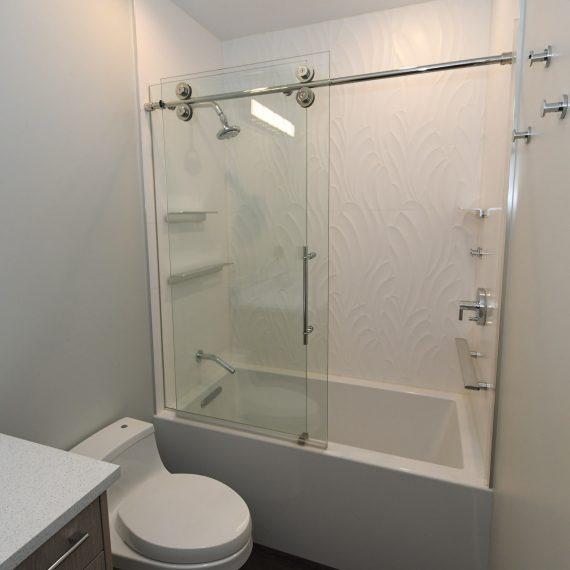 Portfolio - image 624-pearl-304-guest-shower-bath-glass-enclosure-barn-doors-1-570x570 on https://www.flatironsconstruct.com