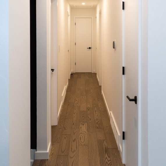 Portfolio - image 7810-durham-way-new-flooring-hallway-570x570 on https://www.flatironsconstruct.com